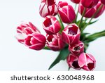 A Bouquet Of Pink Tulips In A...