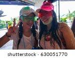 two wet thai women at songkran  ... | Shutterstock . vector #630051770