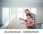 father and son working on... | Shutterstock . vector #630064424