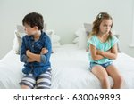sad siblings sitting with arms... | Shutterstock . vector #630069893