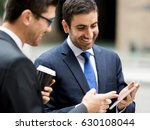 two businessmen talking outdoors | Shutterstock . vector #630108044