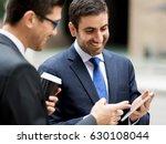 two businessmen talking outdoors | Shutterstock . vector #630108044