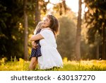 child hugging her pregnant... | Shutterstock . vector #630137270