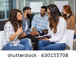 female executives interacting... | Shutterstock . vector #630155708