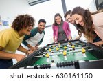 happy executives playing table... | Shutterstock . vector #630161150