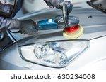 auto mechanic buffing car... | Shutterstock . vector #630234008