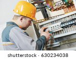 electrician works with electric ... | Shutterstock . vector #630234038