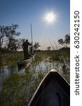 Small photo of People in mokoro canoes in the Okavango Delta, Botswana; Concept for travel in Africa and Safari