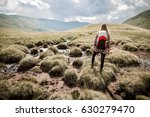 hike in the mountains. woman... | Shutterstock . vector #630279470