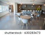 Stock photo empty chair and table in cafeteria at office 630283673