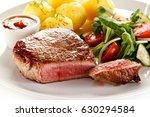 grilled beef steak with... | Shutterstock . vector #630294584