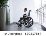 Small photo of Disabled boy patient on wheelchair at hospital