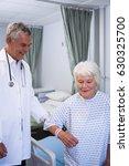 doctor assisting senior patient ... | Shutterstock . vector #630325700
