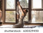 young sporty mother doing... | Shutterstock . vector #630329450