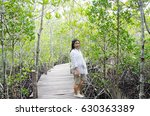 asian woman in mangrove forest... | Shutterstock . vector #630363389