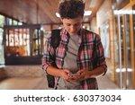 schoolboy using mobile phone in ... | Shutterstock . vector #630373034