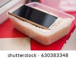 wet smartphone repair in rice | Shutterstock . vector #630383348