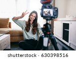 young woman vlogger showing... | Shutterstock . vector #630398516