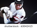 ice hockey player holds stick | Shutterstock . vector #63042415