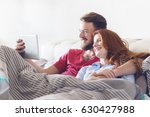 young couple using tablet in a... | Shutterstock . vector #630427988