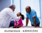 doctor examining patients neck... | Shutterstock . vector #630431543