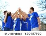group of volunteers in park on... | Shutterstock . vector #630457910