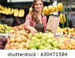 Woman Customer Buying Apple On...
