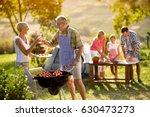 happy grandparents drink wine... | Shutterstock . vector #630473273