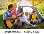 parent and children enjoying on ... | Shutterstock . vector #630475439
