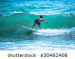 riding the waves. costa rica ... | Shutterstock . vector #630482408