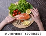raw salmon steaks on the wooden ... | Shutterstock . vector #630486839