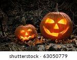halloween pumpkins on rocks in... | Shutterstock . vector #63050779