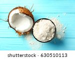 cup with coconut flour and half ... | Shutterstock . vector #630510113