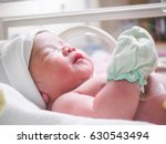 newborn baby girl inside... | Shutterstock . vector #630543494