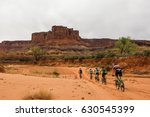Five Cyclists Riding On The...