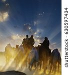 Small photo of Group of camel riders walking in desert, beautiful cloudy sky background. Vertical image and free text space for holiday, wildlife advertorial ad. Beautiful Nature and Sunset