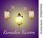 ramadan kareem lantern.  glow... | Shutterstock .eps vector #630603560