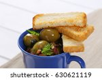 cup of marinated green olives...