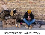 Homeless Man Sitting On The...