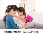 beautiful mother hug with cute... | Shutterstock . vector #630634448