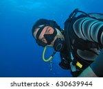 happy scuba diver underwater... | Shutterstock . vector #630639944