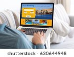 man on sofa in room typing on... | Shutterstock . vector #630644948