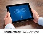 man hands holding tablet... | Shutterstock . vector #630644990