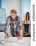 male graphic designer leaning... | Shutterstock . vector #630666338