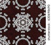 seamless pattern on brown...   Shutterstock .eps vector #630698690