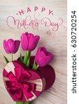 three tulip in red gift box in...   Shutterstock . vector #630720254