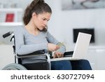 disabled lady buying online | Shutterstock . vector #630727094