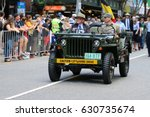 Small photo of BRISBANE, AUSTRALIA - APRIL 25, 2017: Elderly veteran is driven in a left hand drive jeep during the ANZAC parade.