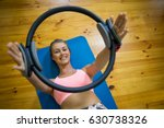 smiling fit woman exercising... | Shutterstock . vector #630738326