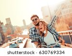 happy young couple going for a... | Shutterstock . vector #630769334